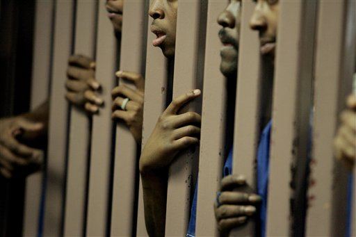 Black-prisoners-behind-bars-