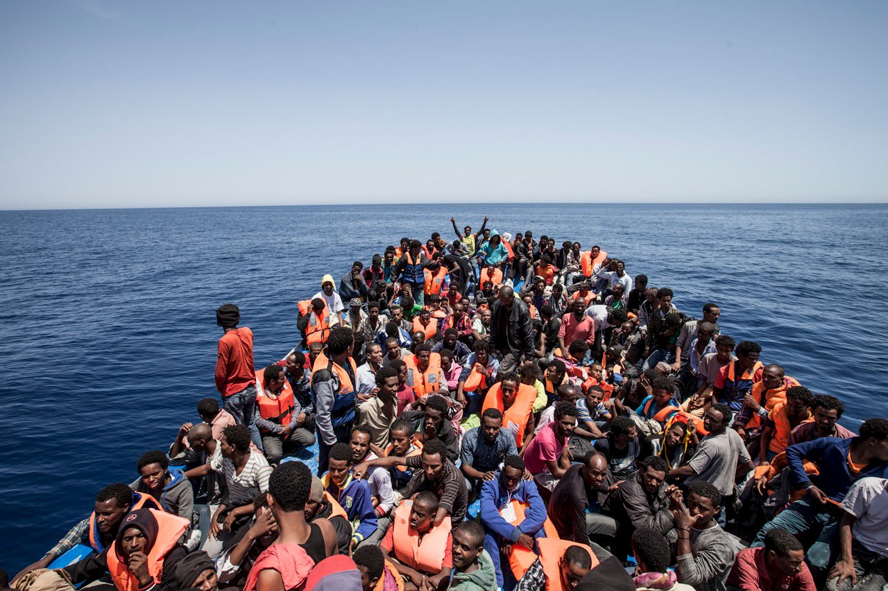Migrants crowd the deck of their wooden boat off the coast of Libya May 14, 2015.  International non-governmental organisations Medecins sans Frontieres (MSF) and MOAS (Migrant Offshore Aid Station) rescued 561 migrants at sea off the coast of Libya on Thursday, according to Maltese media. Their vessel, the Phoenix, is the first privately funded vessel to operate in the Mediterranean. Almost 3,600 migrants have been rescued from overcrowded boats sailing from Africa to Europe over the past 48 hours, Italy said on Thursday, with sea conditions seen as perfect for attempting the crossing. REUTERS/MOAS/Jason Florio/Handout via Reuters  ATTENTION EDITORS - NO SALES. NO ARCHIVES. FOR EDITORIAL USE ONLY. NOT FOR SALE FOR MARKETING OR ADVERTISING CAMPAIGNS. THIS IMAGE HAS BEEN SUPPLIED BY A THIRD PARTY. IT IS DISTRIBUTED, EXACTLY AS RECEIVED BY REUTERS, AS A SERVICE TO CLIENTS        TPX IMAGES OF THE DAY