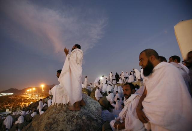 Muslim pilgrims pray on Mount Mercy on the plains of Arafat outside the holy city of Mecca December 7, 2008. More than two million Muslims began the haj pilgrimage on Saturday, heading to a tent camp outside Mecca to follow the route Prophet Mohammad took 14 centuries ago. REUTERS/Ahmed Jadallah (SAUDI ARABIA)