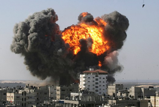 An explosion is seen after after an Israeli air strike in the southern Gaza Strip town of Rafah near the border with Egypt on January 13, 2009. Israeli troops and Hamas fighters fought fierce battles in the streets of Gaza's main city on Tuesday as Israel's war on Hamas entered its 18th day and the death toll spiralled above 900. AFP PHOTO/SAID KHATIB ALTERNATIVE CROP