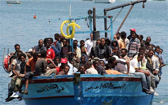 Would-be immigrants arrive on a boat in...Would-be immigrants arrive on a boat in the port of Italy's southern island of Lampedusa late on July 31, 2008. Italy's coast guard intercepted around 800 illegal immigrants on five boats off the island of Lampedusa on July 31. One boat, carrying 339 people, including 47 women and four children, got as far as the Sicilian island's port. The reception centre on Lampedusa, which can hold 700 immigrants, was overwhelmed by the scale of new arrivals after some 400 illegal immigrants turned up on the island.     AFP PHOTO / Mauro Seminara (Photo credit should read Mauro Seminara/AFP/Getty Images)
