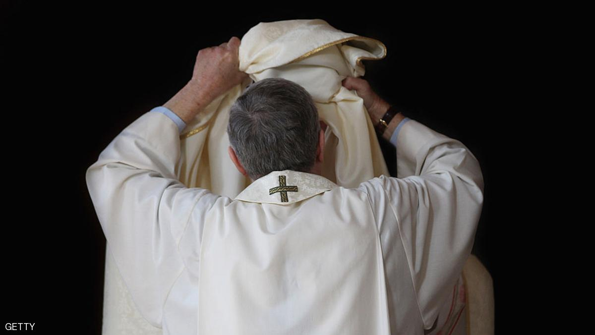 LONDON, ENGLAND - APRIL 03:  A priest tries on his new clerical vestments ahead of the annual Chrism Mass in Westminster Cathedral on April 3, 2012 in London, England. The Archbishop of Westminster Vincent Nichols took part in the service joined by 350 priests wearing the new vestments which were introduced for clergy of the Diocese of Westminster. The design of the new vestments reflects key colours and geometrical patterns present in Westminster Cathedral.  (Photo by Dan Kitwood/Getty Images)