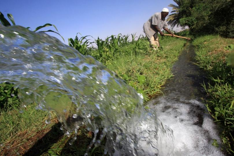 111239-a-sudanese-farmer-prepares-his-land-for-irrigation-on-the-banks-of-the