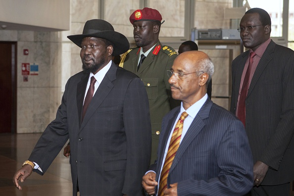 South Sudan's President Salva Kiir (L) walks prior to a meeting on March 3, 2015 in Addis Ababa, as part of the latest round of peace talks to end over 14 months of conflict, just 48 hours ahead of a deadline to strike a deal. Regional bloc IGAD has set a March 5 deadline for South Sudan's warring rival leaders President Salva Kiir and rebel chief Riek Machar to reach a final peace agreement, but previous deadlines have been repeatedly missed or ignored despite the threat of sanctions. Fighting broke out in South Sudan, the world's youngest nation, in December 2013 when Kiir accused his sacked deputy Machar of attempting a coup. Tens of thousands of people have died in the conflict, 1.5 million have been displaced and 2.5 million are in dire need of food aid in South Sudan, which declared independence from Sudan in 2011.  AFP PHOTO / ZACHARIAS ABUBEKER        (Photo credit should read ZACHARIAS ABUBEKER/AFP/Getty Images)
