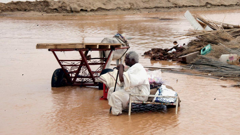 A Sudanese sits amongst the remains of his home following floods in Kassala, near Khartoum, Sudan Tuesday, July 10, 2007.  At least fifteen  were killed and some five thousand houses were destroyed in Khartoum, Kassala and the White Nile states in central Sudan. (AP Photos/Abd Raouf)