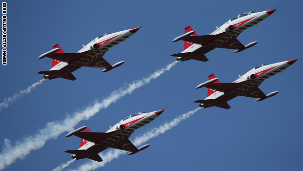 SEDD EL BAHR, TURKEY - APRIL 23:  Planes of the Turkish air force fly in formation over Helles Point, where Allied soldiers fought during the Gallipoli Campaign, during rehearsals for upcoming commemorative ceremonies on April 23, 2015 near Sedd el Bahr, Turkey. Allied and Turkish representatives, as well as family members of those who served, will commemorate the 100th anniversary of the campaign with ceremonies scheduled for April 24-25. The Gallipoli land campaign, in which a combined Allied force of British, French, Australian, New Zealand and Indian troops sought to occupy the Gallipoli peninsula and the strategic Dardanelles strait during World War I, began on April 25, 1915 against Turkish forces of the Ottoman Empire. The Allies, unable to advance more than a few kilometers, withdrew after eight months. The campaign cost the Allies approximately 45,000 killed and up to 200,000 wounded, the Ottomans approximately 85,000 killed and 160,000 wounded.  (Photo by Sean Gallup/Getty Images)