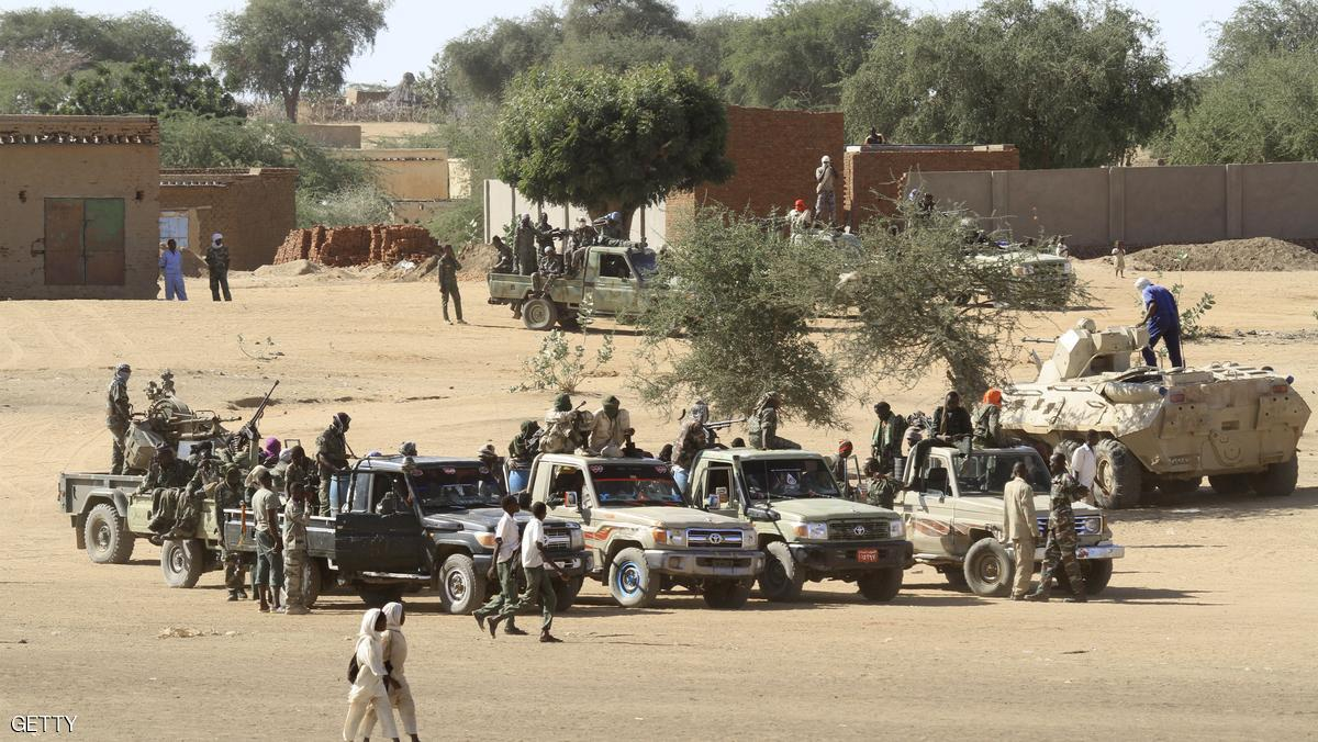 A picture taken during a government organised tour shows Sudanese troops standing guard in the village of Tabit, in the North Darfur, on November 20, 2014. A local news website had reported Sudanese troops entered the village of Tabit on October 31 after a soldier went missing and raped 200 girls and women, which Khartoum has denied A UN-African mission in Darfur (UNAMID) team was barred entry to Tabit on November 4, but returned five days later and found no evidence of the mass rape, promising to follow up with further investigations. While UNAMID said it found no evidence to support the report after its first visit to Tabit, an internal report from the mission last week said the Sudanese military had tried to intimidate villagers as the peacekeepers interviewed them.  AFP PHOTO/ASHRAF SHAZLY        (Photo credit should read ASHRAF SHAZLY/AFP/Getty Images)