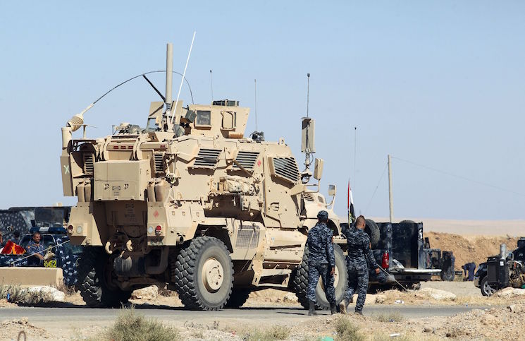 US-made armored combat vehicle is seen parked at the Qayyarah military base, about 60 kilometres (35 miles) south of Mosul, on October 16, 2016, as they prepare for an offensive to retake Mosul, the last IS-held city in the country, after regaining much of the territory the jihadists seized in 2014 and 2015. / AFP PHOTO / AHMAD AL-RUBAYE