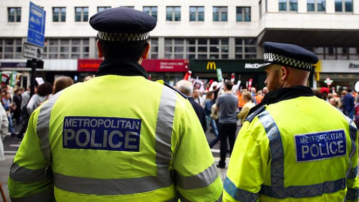 Charlotte Church Attends Anti Austerity Demonstration...LONDON, ENGLAND - JUNE 20:  Police watch an Anti Austerity demonstration at Bank Of England on June 20, 2015 in London, England.  Thousands of people gathered to march from the City of London to Westminster, where they listened to addresses from singer Charlotte Church and comedian Russell Brand as well as Len McCluskey, general secretary of Unite and Sinn Fein's Martin McGuinness.  (Photo by Zak Kaczmarek/Getty Images)