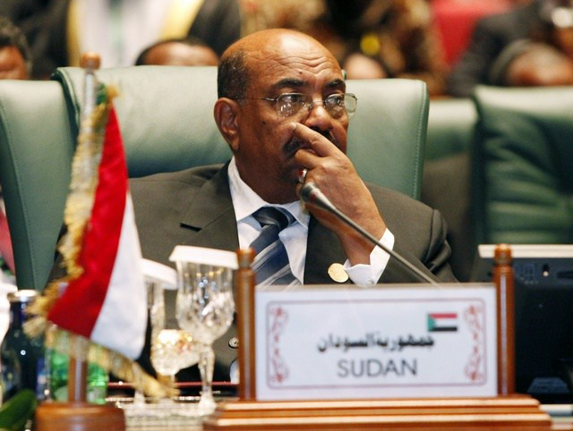 Sudanese President Omar al-Bashir attends the opening session of the second Afro-Arab Summit in Sirte October 10, 2010. REUTERS/Ismail Zitouny (LIBYA - Tags: POLITICS)