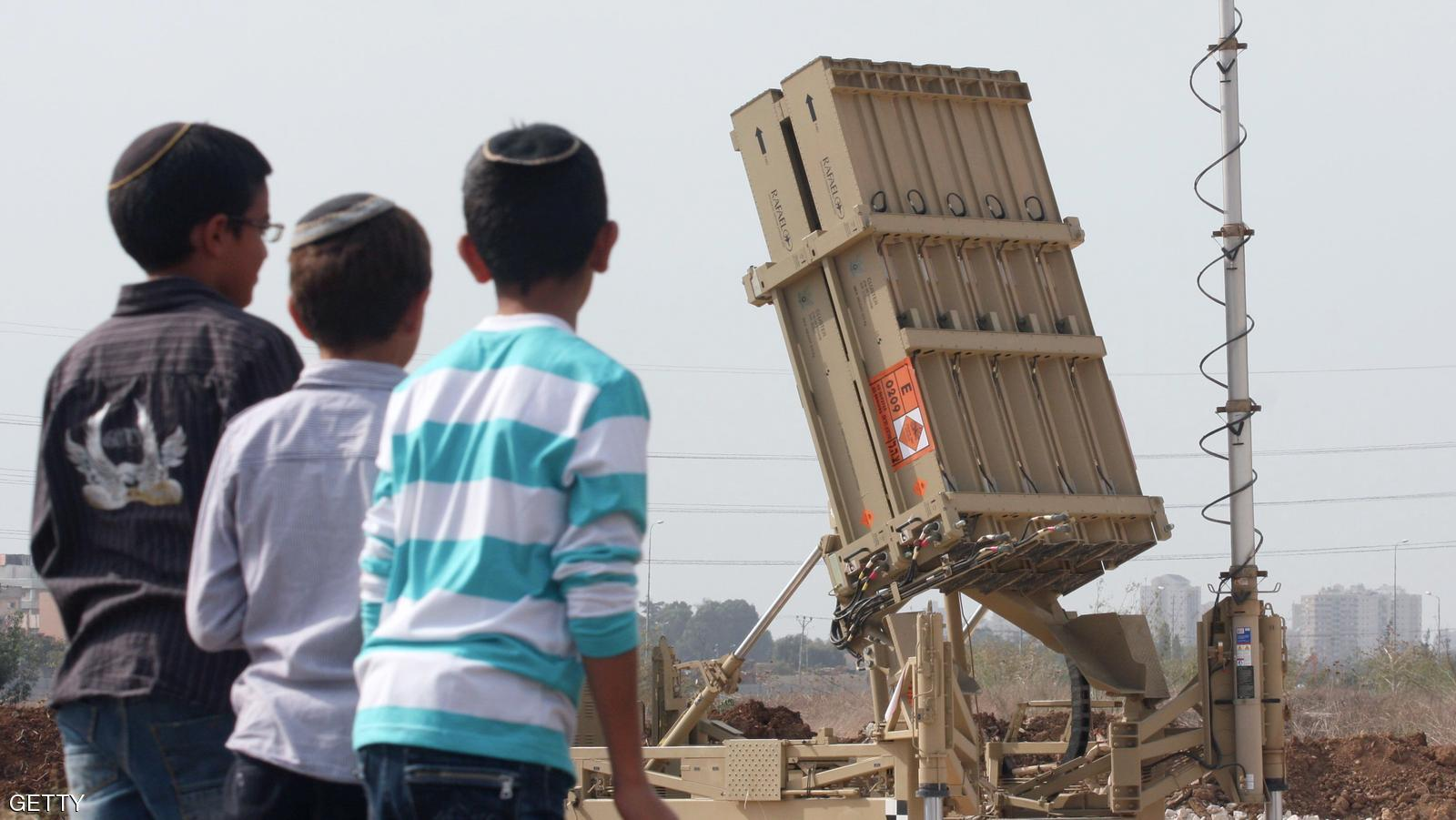 ---ISRAEL OUT--- Israeli children look at the Israeli military's Iron Dome defence missile system, designed to intercept and destroy incoming short-range rockets and artillery shells, deployed in Gush Dan, the Tel Aviv metropolitan area, on November 17, 2012. Since the start of the Israeli's ongoing military operation, Israel's army says Palestinian militants have fired more than 580 rockets over the border, 367 of which hit southern Israel, and 222 of which were intercepted by the Iron Dome anti-missile system. Hamas's military wing said it fired a rocket at Jerusalem, and witnesses said another crashed into the sea off Tel Aviv on November 16. AFP PHOTO/RONI SCHUTZER        (Photo credit should read RONI SCHUTZER/AFP/Getty Images)