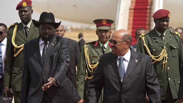 Sudan's President Omar al-Bashir (R) and South Sudan's President Salva Kiir (L) are pictured at Juba airport in Juba on April 12, 2013.  Bashir arrived in South Sudan  for the first time since his 2011 visit for the country's independence, a sign of easing tensions after bloody border battles in 2012. AFP PHOTO/Ali Ngethi        (Photo credit should read ALI NGETHI/AFP/Getty Images)