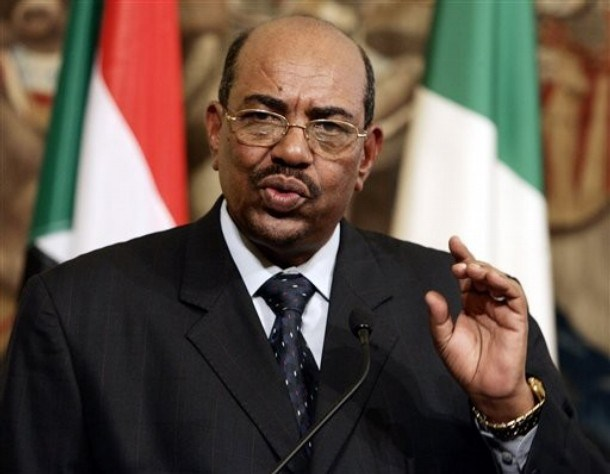 Sudan's President Omar al-Bashir gestures during a joint press conference with Italian Premier Romano Prodi, not seen, at the end of their meeting at Chigi palace, Premier's office, in Rome, Friday, Sept. 14, 2007. President Omar al-Bashir, who came to power in 1989 in a military and Islamic coup, arrived in Rome a few weeks before the expected deployment of an international peacekeeping force to try to improve the security situation in the war-ravaged western Sudanese region of Darfur. More than 200,000 people have died and 2.5 million have been uprooted since ethnic African rebels in Darfur took up arms against the Arab-dominated Sudanese government in 2003. (AP Photo/Gregorio Borgia)