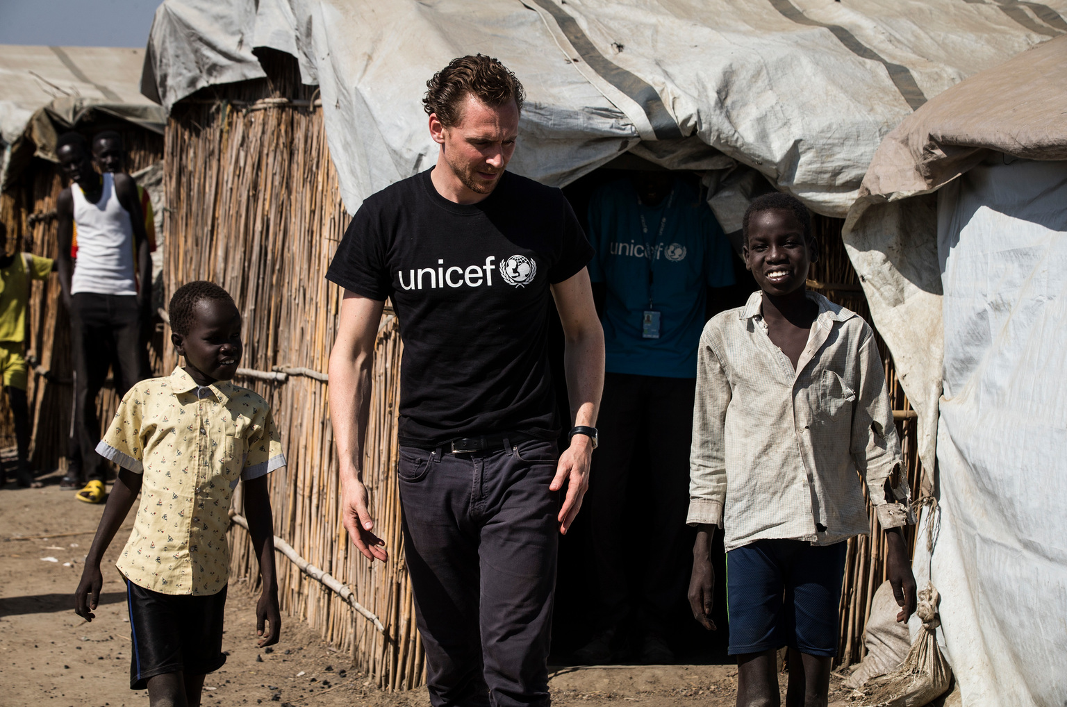 Unicef UK Ambassador Tom Hiddleston meets brothers Buom, 12 (right) and Jal, 9, who have been separated from their mother since the conflict began in 2013,  at the POC (Protection of Civilians) camp in Bentiu, South Sudan, November 25, 2016. Unicef UK Ambassador Tom Hiddleston returns to South Sudan as the brutal conflict enters its third year to see the effect it has had on children.  UNICEF UK/Siegfried Modola EMBARGO 00:01 30 November 2016  UNICEF Ambassador Tom Hiddleston travelled to South Sudan last week to see how the brutal civil war continues to destroy the lives of vast numbers of children across the country. Mid-December will mark three years of conflict in South Sudan. On his second visit since February 2015, Hiddleston saw how conditions remain as fragile and severe as ever.