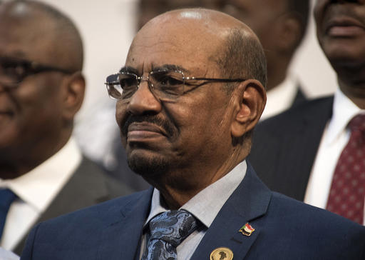 FILE - In this June 14, 2015 file photo, Sudanese President Omar al-Bashir smiles during a visit to Johannesburg, South Africa. A South African court ruled Wednesday, Feb. 22, 2017 that the government's decision to withdraw from the International Criminal Court without parliament's approval was unconstitutional. ??South Africa's withdrawal announcement last year followed a 2015 dispute over a visit by Sudanese President Omar al-Bashir, who is wanted by the ICC for alleged war crimes, crimes against humanity and genocide in Darfur. (AP Photo/Shiraaz Mohamed, File)