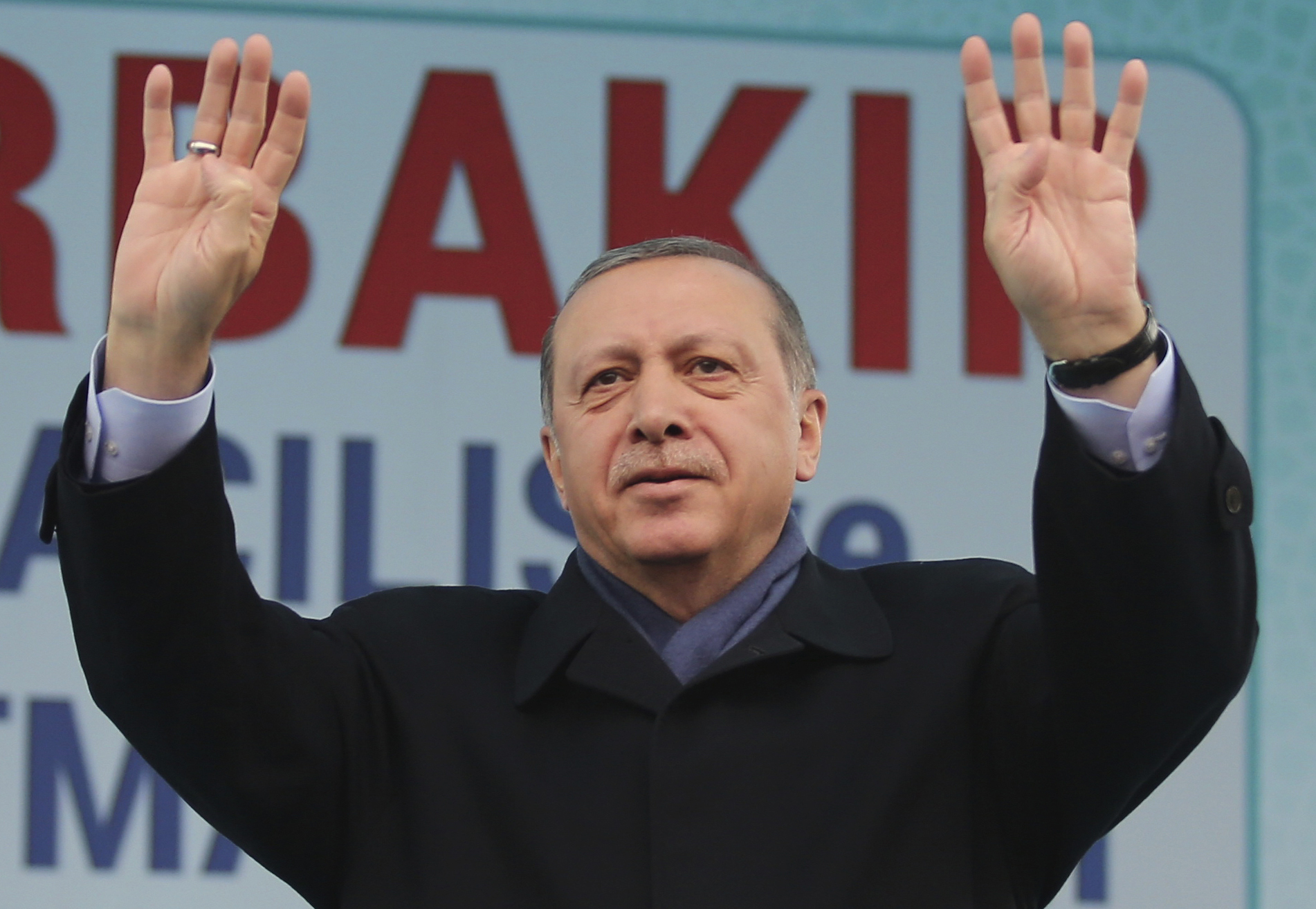 Turkey's President Recep Tayyip Erdogan waves to supporters prior to his speech during a rally ahead of the upcoming referendum, in the pre-dominantly Kurdish city of Diyarbakir, in southeastern Turkey, Saturday, April 1, 2017. Turkey is heading to a contentious April 16 referendum on constitutional reforms to expand Erdogan's powers. (AP Photo)