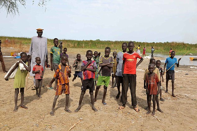 The Mail goes to see the effects of the appalling famine in Ganyiel, South Sudan. A group of skinny kids, pictured in the famine affected area of Ganyiel, Sth Sudan.