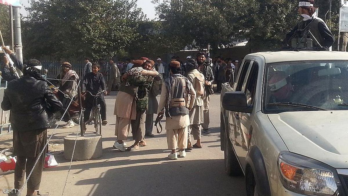 Taliban fighters hug each other a day after they overran the strategic northern city of Kunduz, on September 29, 2015.  Afghanistan on September 29, 2015, mobilised reinforcements for a counter-offensive to take back Kunduz, a day after Taliban insurgents overran the strategic northern city in their biggest victory since being ousted from power in 2001.   AFP PHOTO        (Photo credit should read STR/AFP/Getty Images)