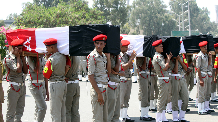 epa03347811 Egyptian Army military personnel carry coffins of some of the 16 Egyptian soldiers killed in an attack on an army outpost in the border town of Rafah, during the funeral in Cairo, Egypt, 07 August 2012. Egypt has sealed off Sinai in the wake of the attack, and announced the indefinite closure of the Rafah border crossing. Egyptian President Mohamed Morsi, who took office on 30 June, promised a harsh response to the attack and said the military would bring Sinai under control.  EPA/KHALED ELFIQI